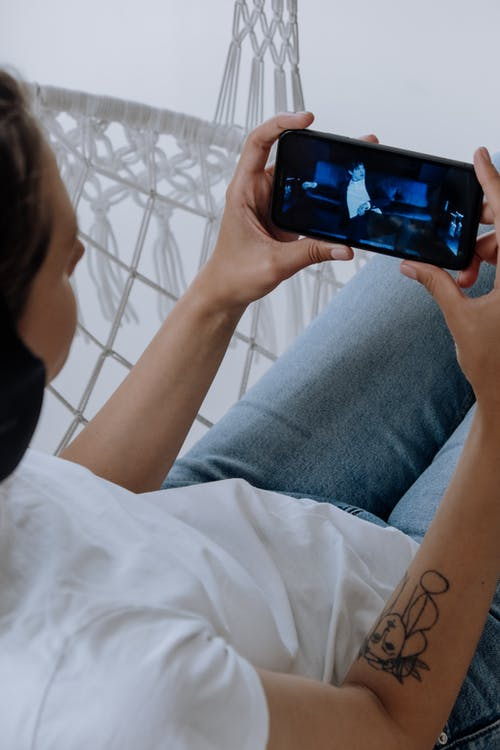 guy looking at a video on smartphone